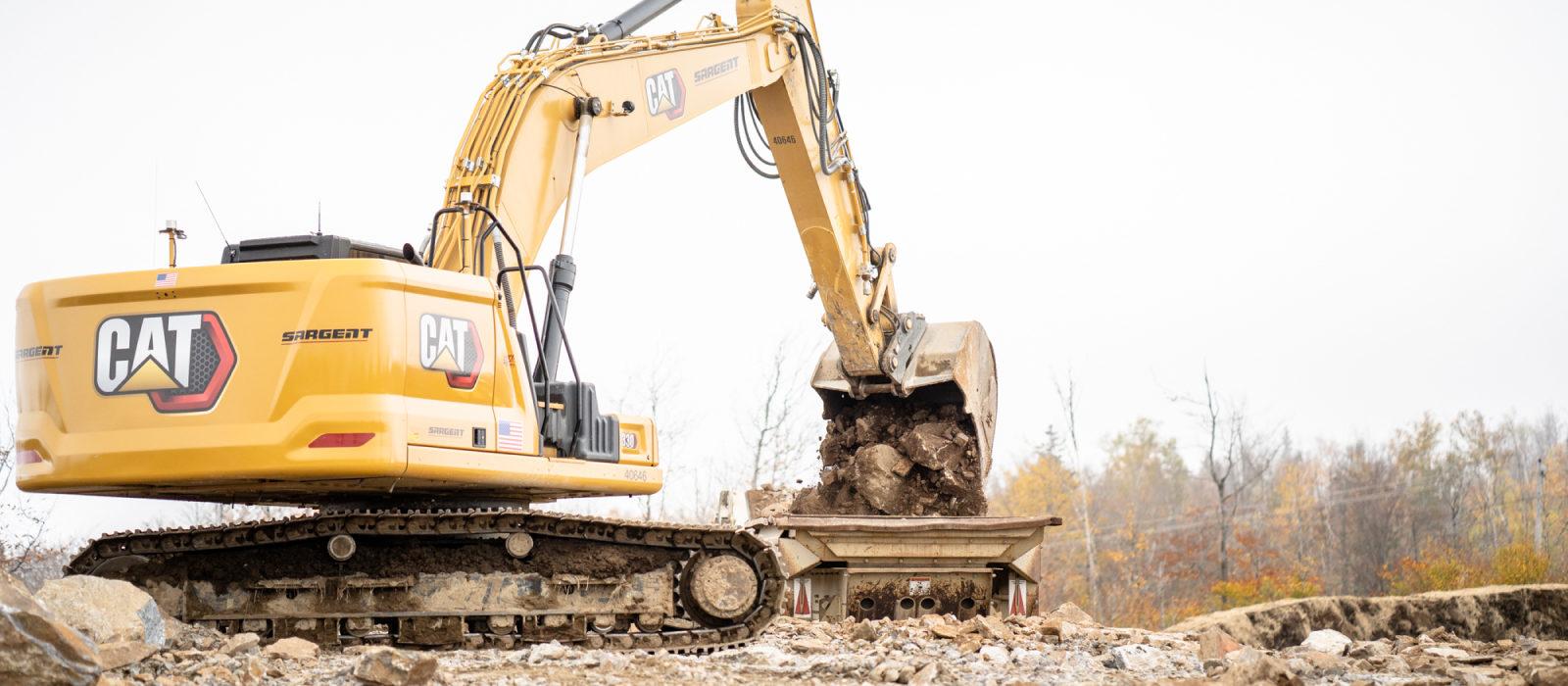 Lagre Excavator Lifting Large Rocks