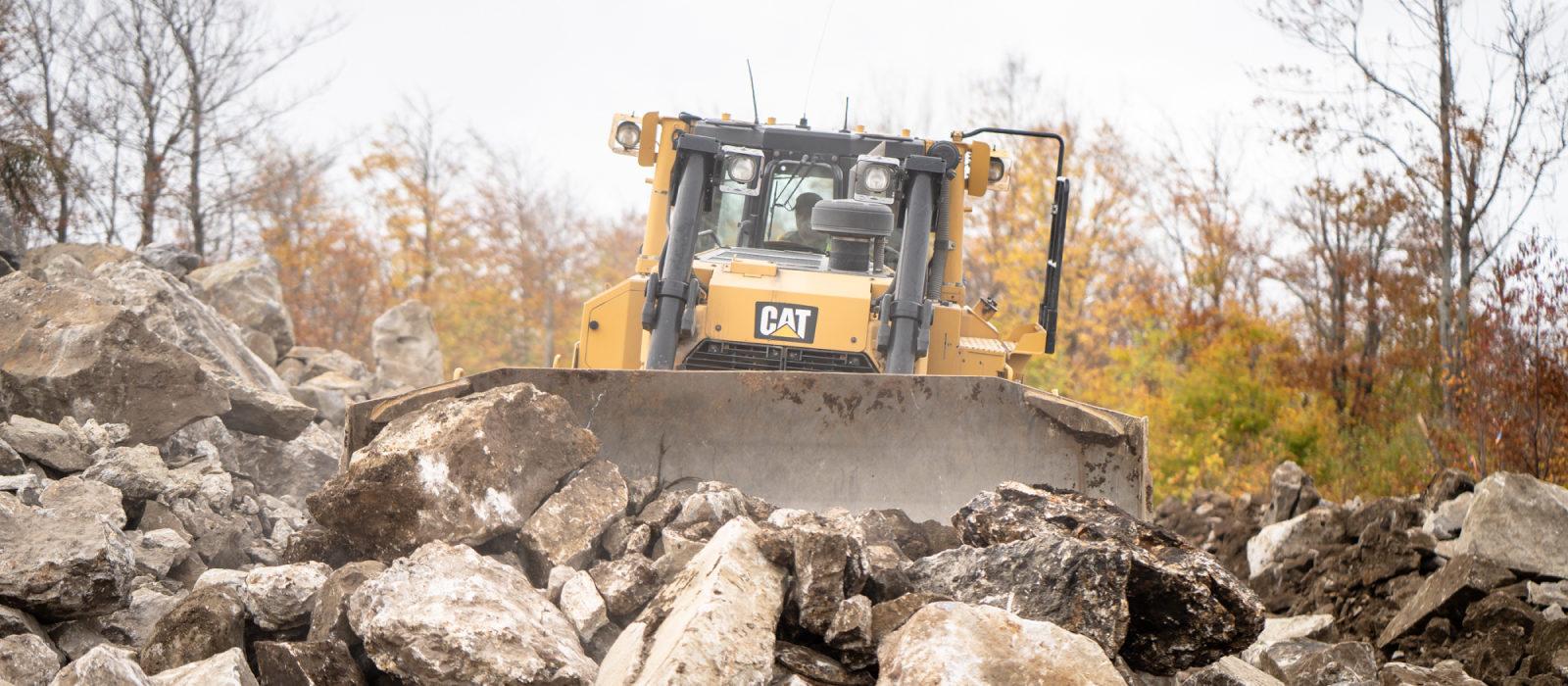 Large Size Of Bulldozers Pushing Large Size Rocks