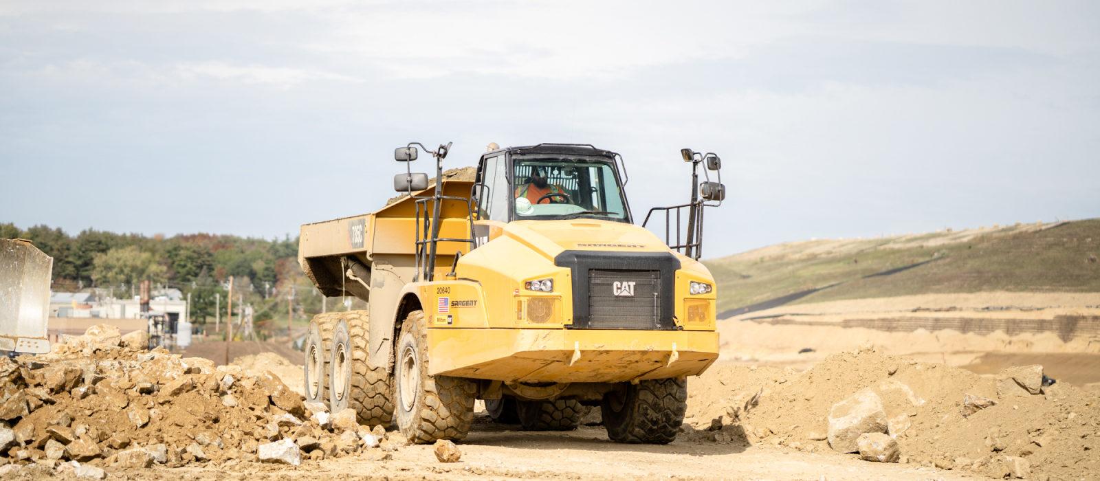 Sargent's CAT 735C Transporting Dirt Soil