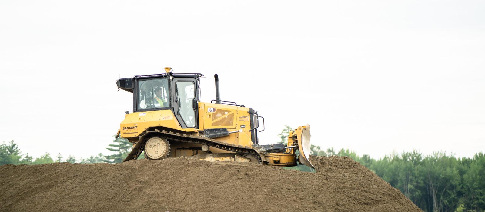 Medium Size Bulldozer On Moving Soil
