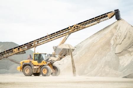 Excavator On Lifting Asphalt Aggregates