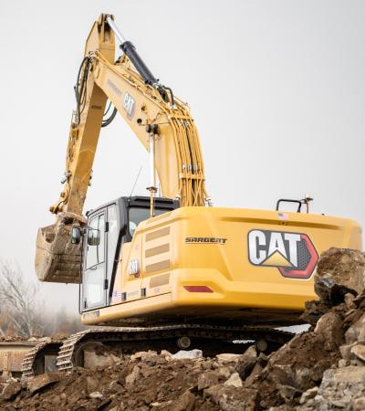 Excavator Lifting Rock Soil